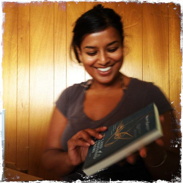 Nayomi beaming at her book