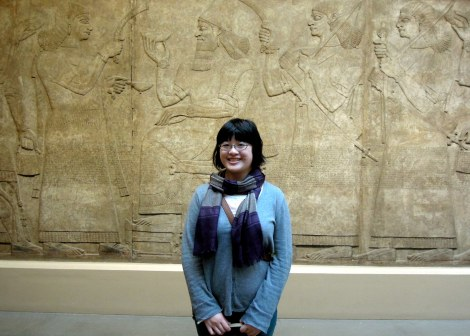 Lisa in front of Assyrian reliefs