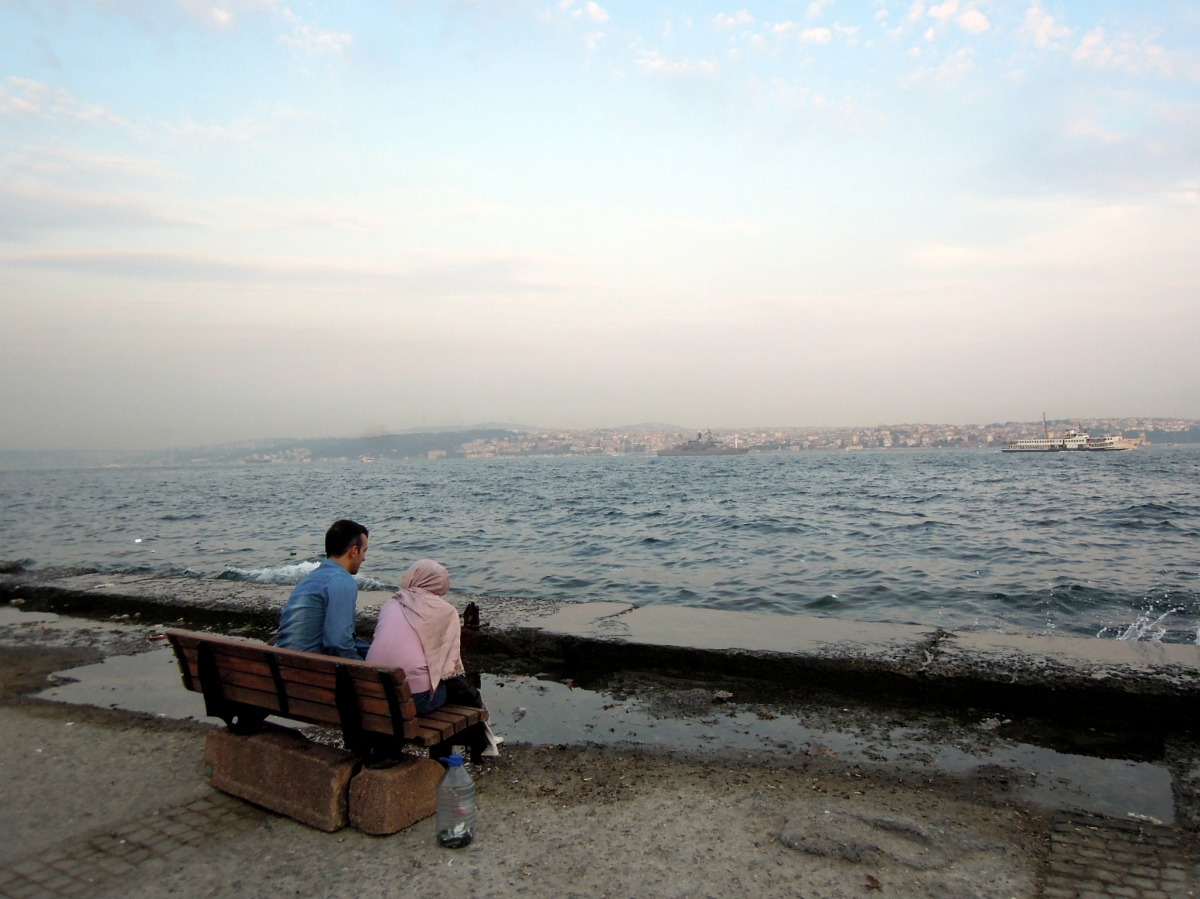 Couple sitting next to the water