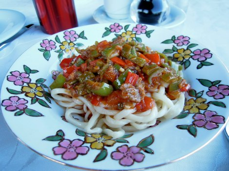 Uighur lagman (handmade noodles) topped with ground meat and diced vegetables