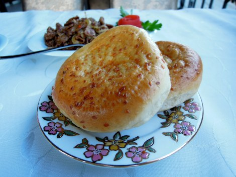 Uighur naan, topped with sesame seeds
