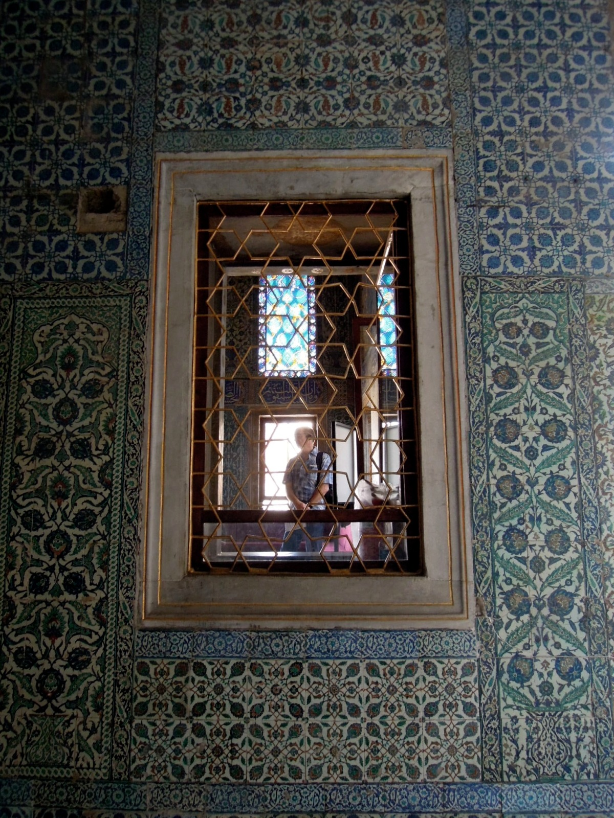 Window with star-patterned gold grille