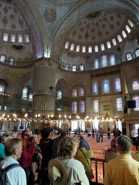 Tourists and the prayer area inside the Blue Mosque