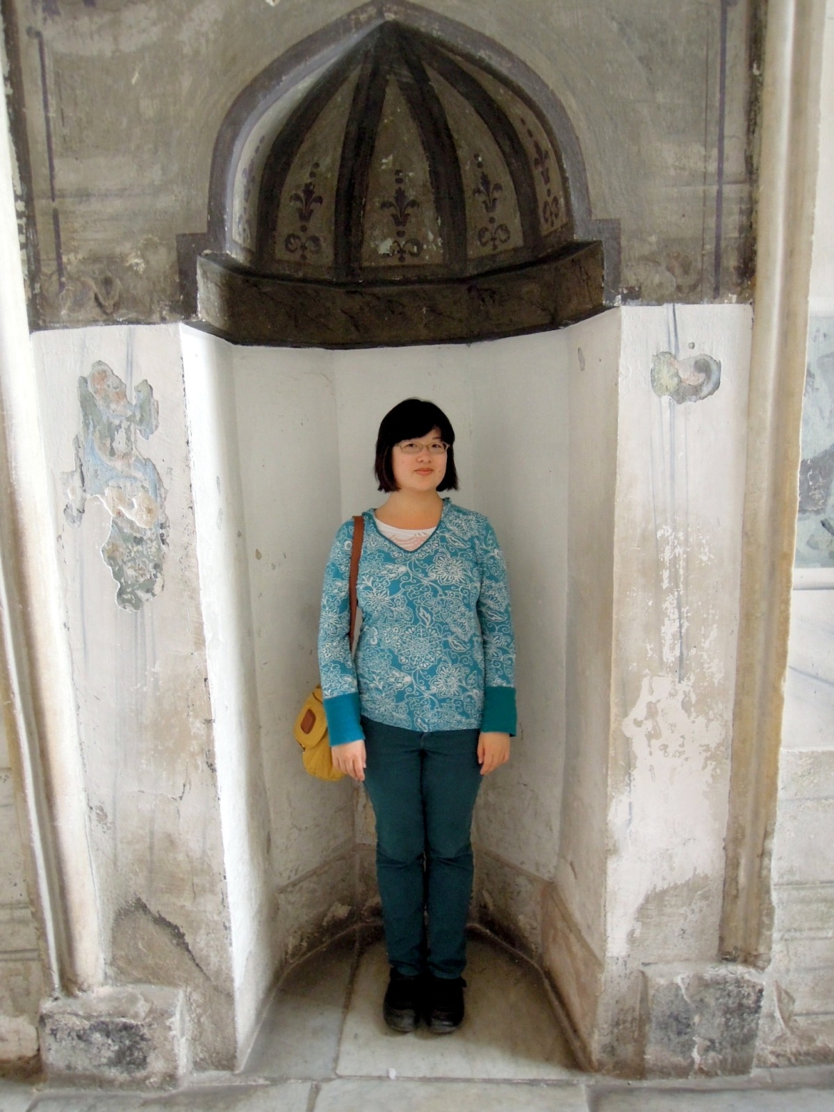Lisa standing in an alcove