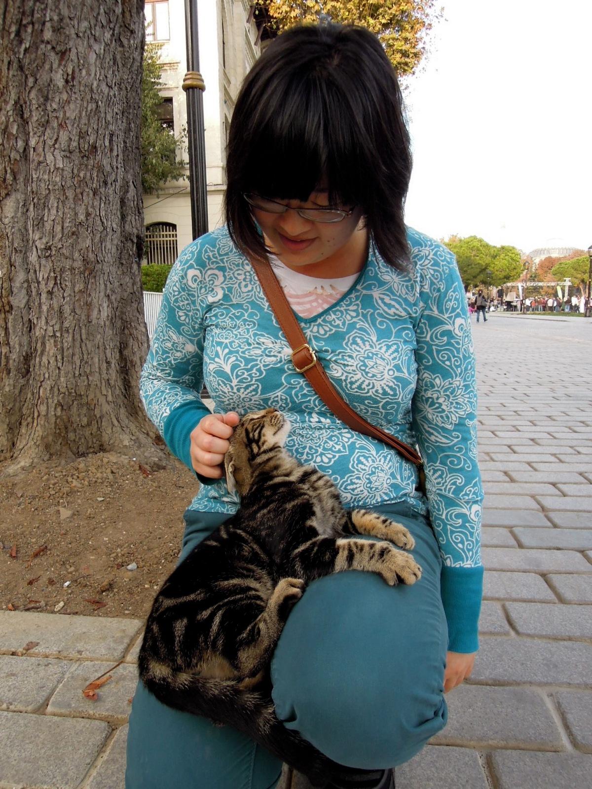 Lisa petting a kitty