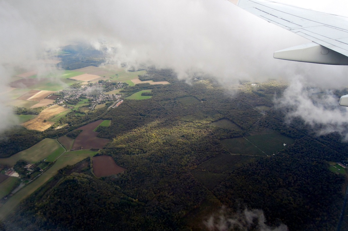 Aerial view of fields and forest outside Paris