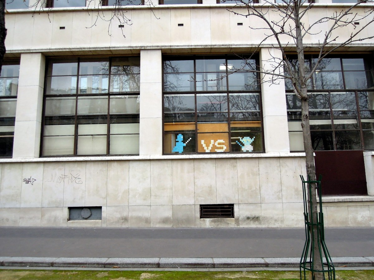 Post-it art in a window, showing Darth Vader battling Yoda.