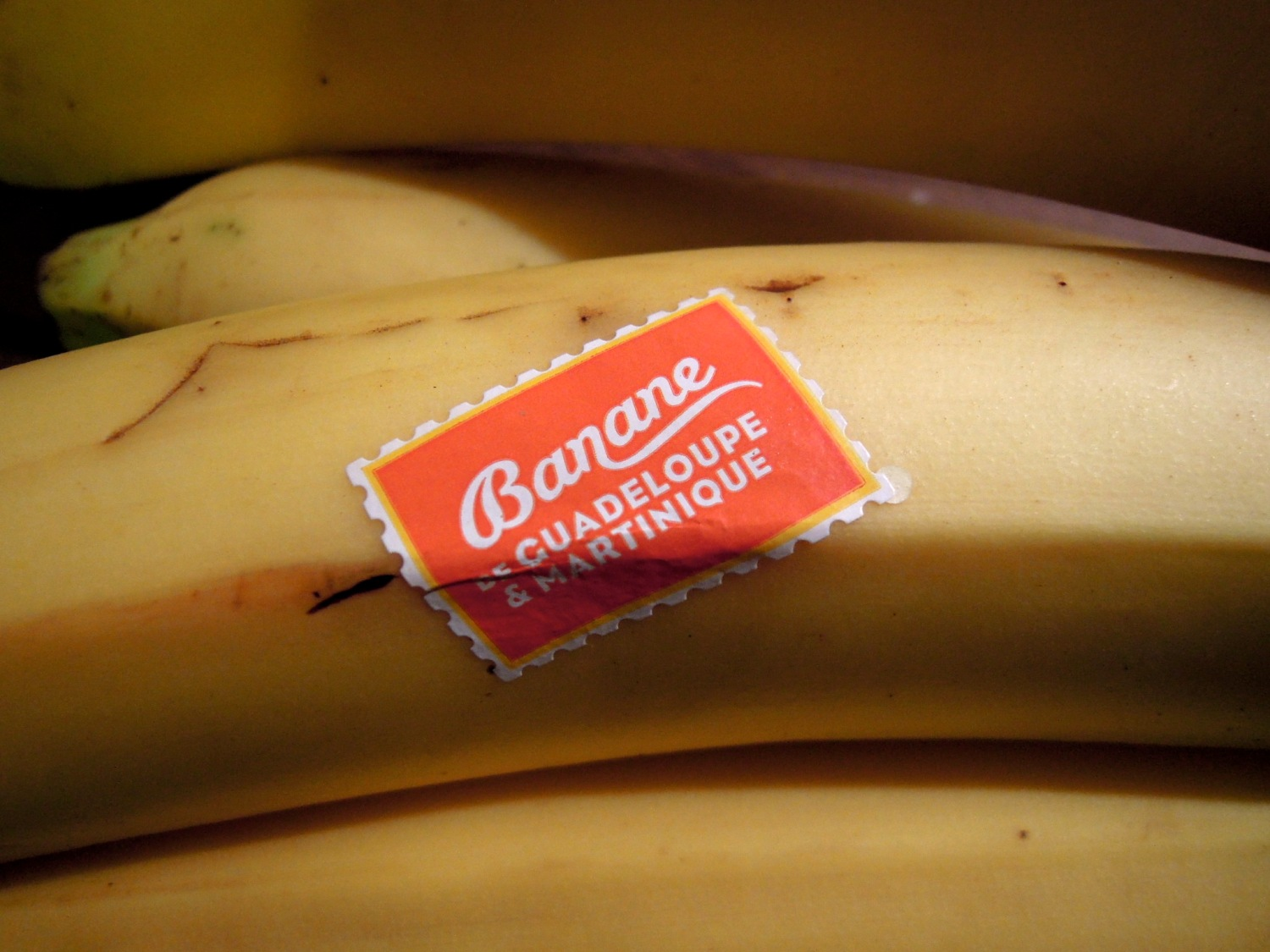 Bananas with sticker saying they are from Guadeloupe or Martinique