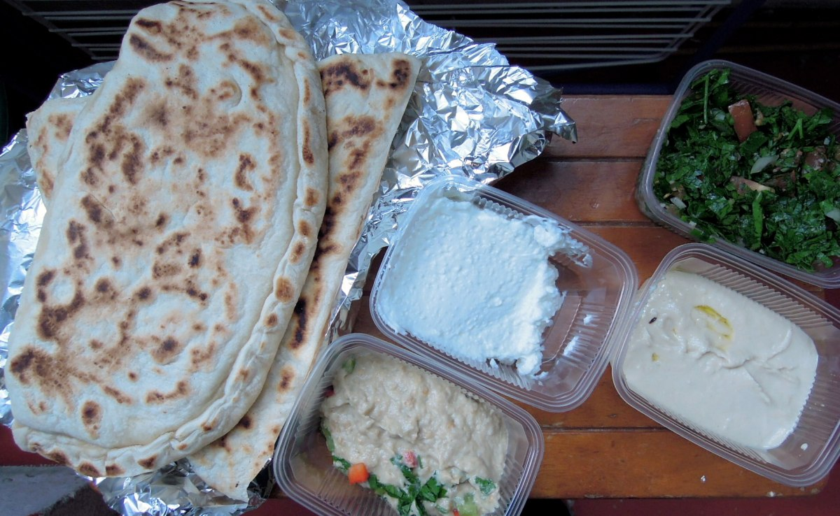 Lebanese lunch: filled flatbreads, hummus, eggplant dip, tabbouleh, garlic cream
