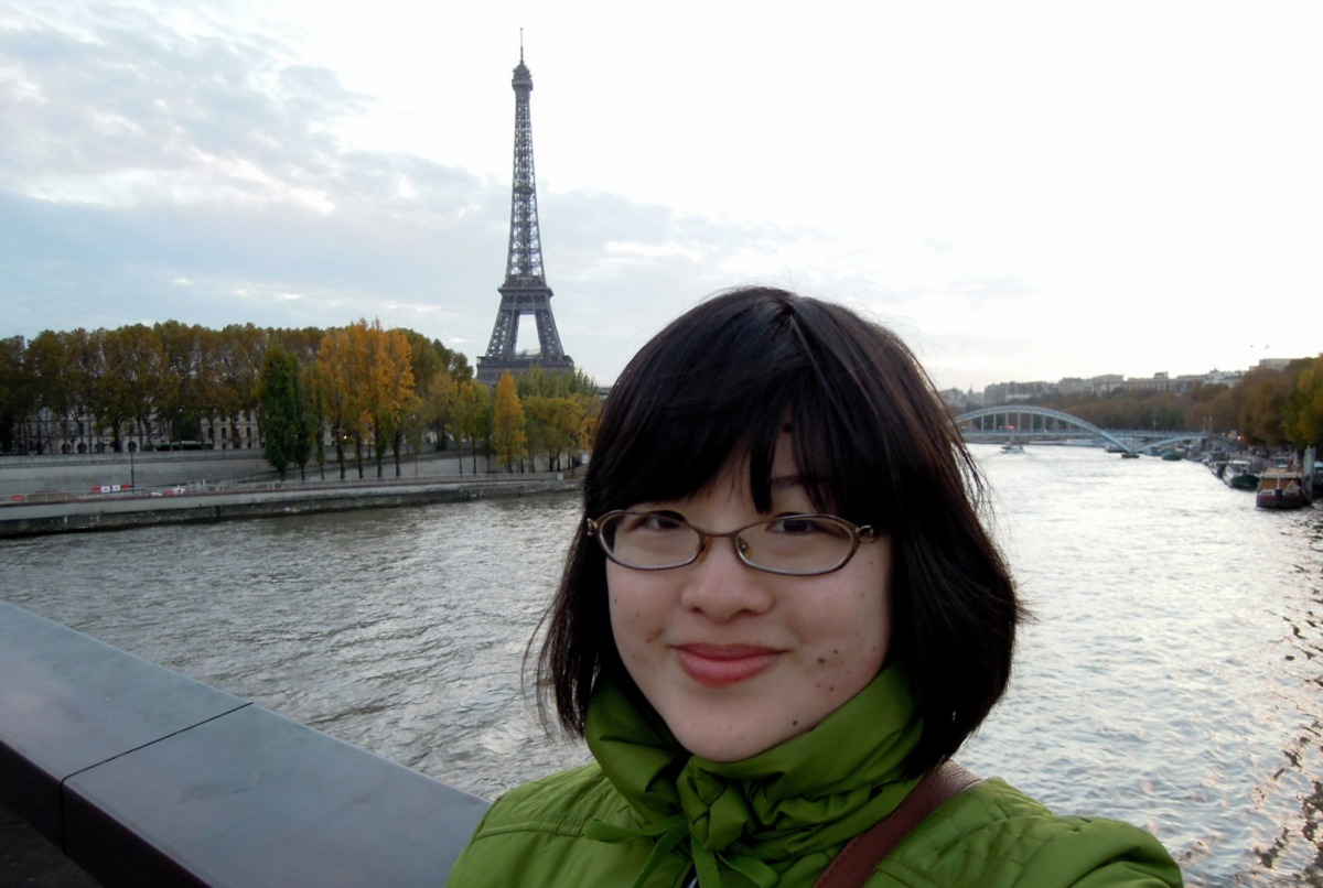Lisa with the Eiffel Tower in the background