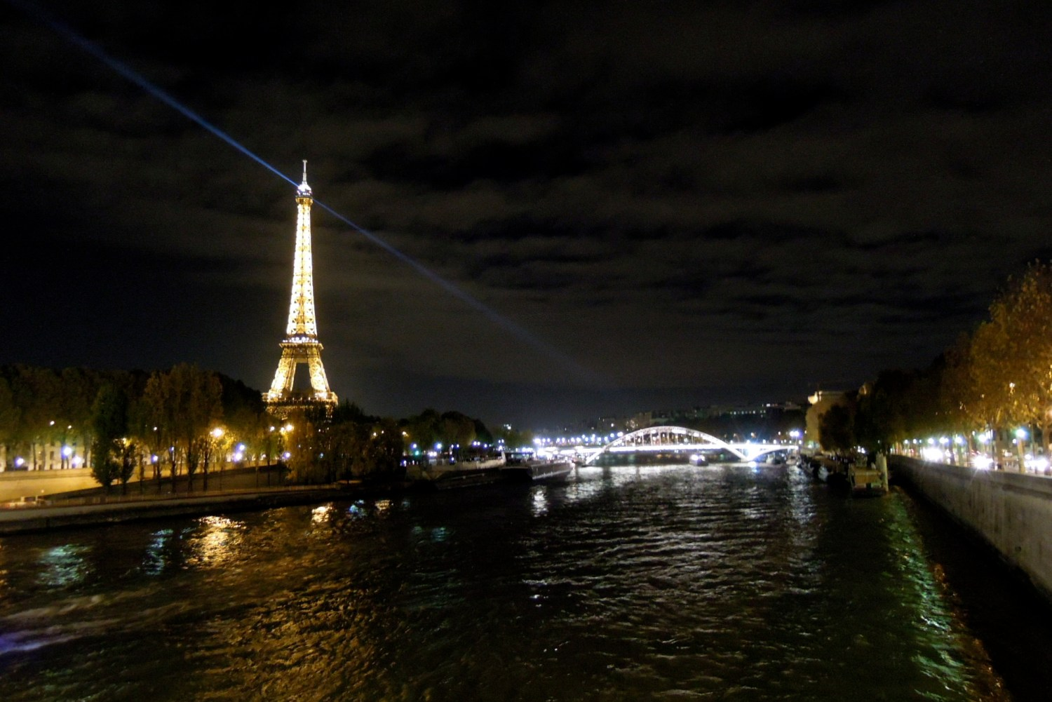 Eiffel Tower and the Seine by night