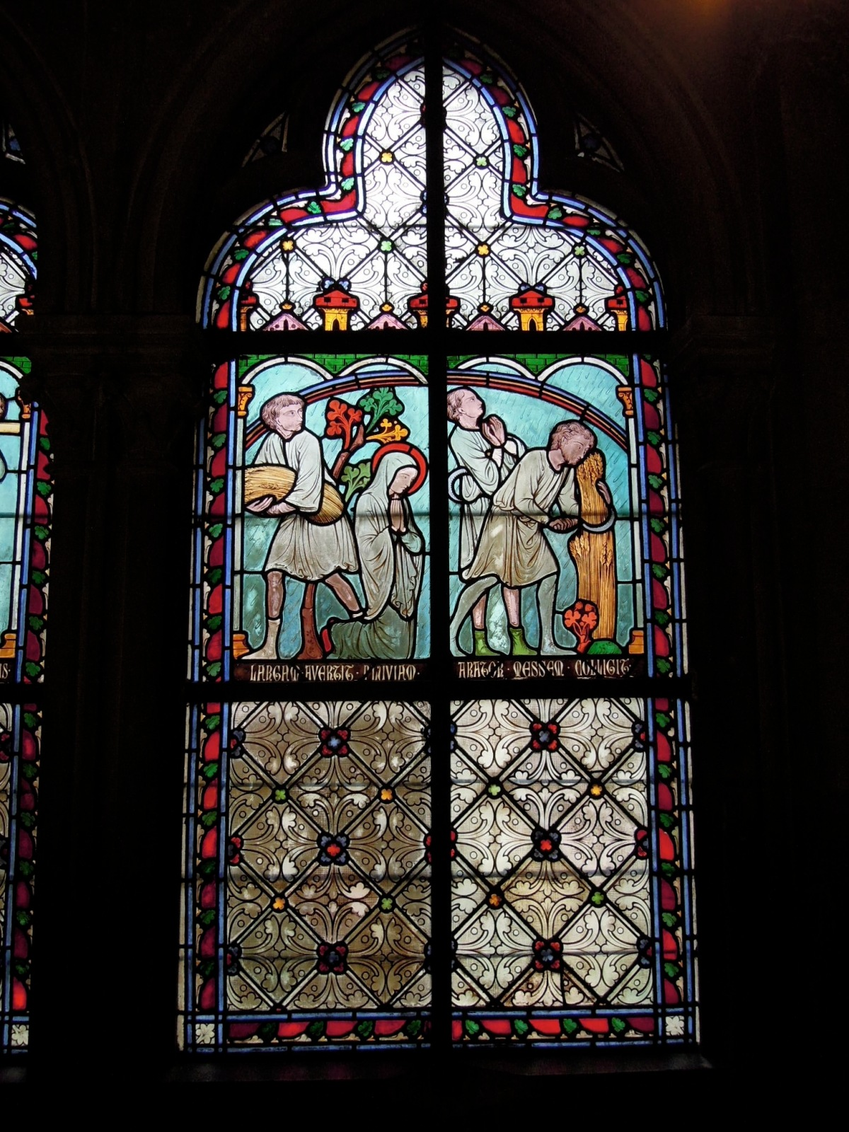 Stained-glass window with words and picture