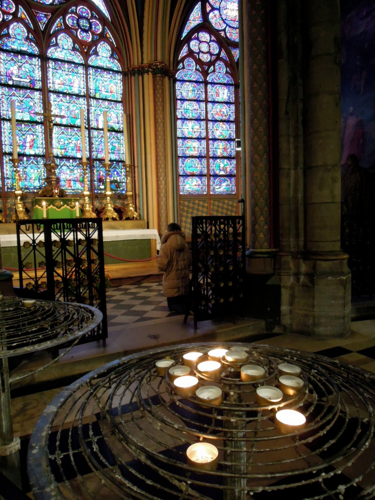 Prayer area with stained glass windows and candles