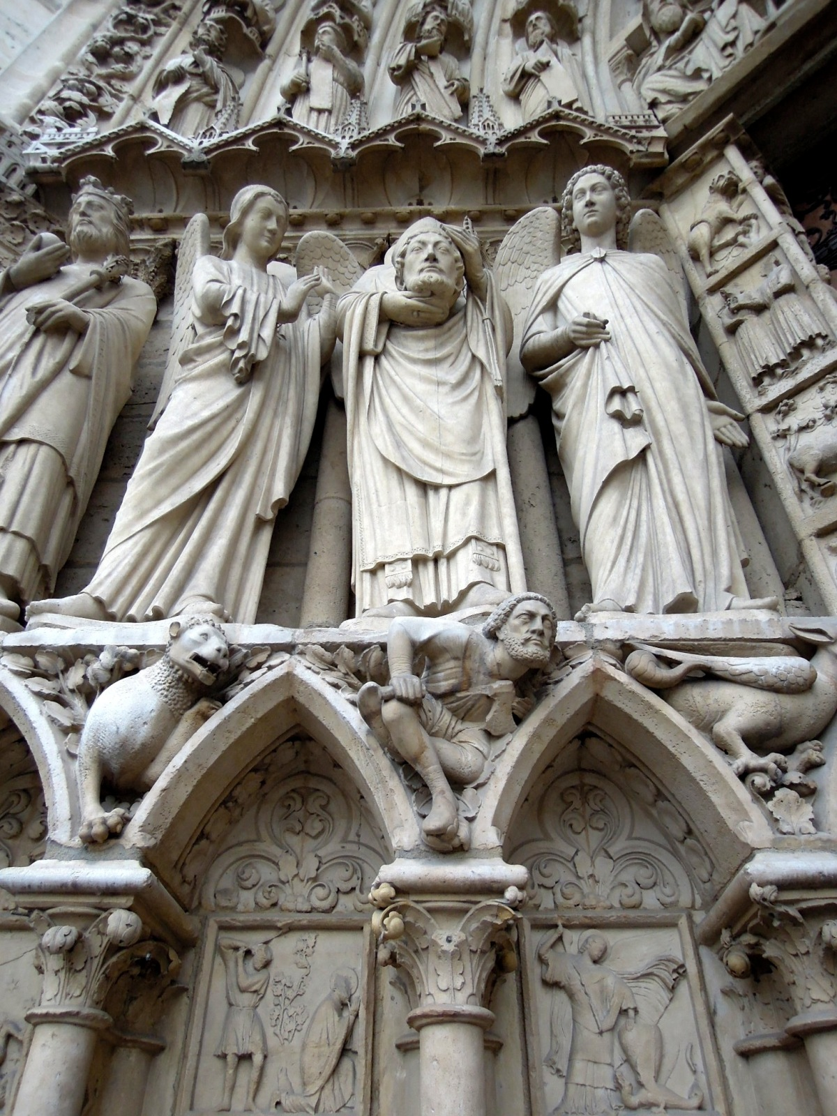 Elaborate carved statues on the side of the building exterior