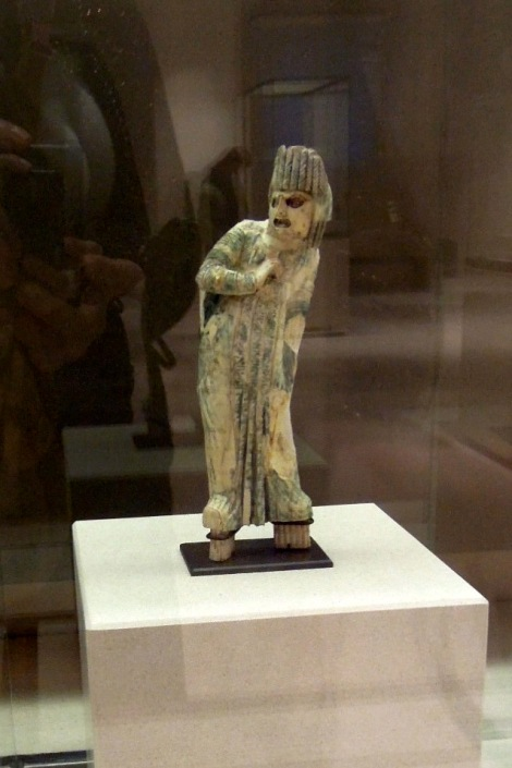 Statuette of a posing figure