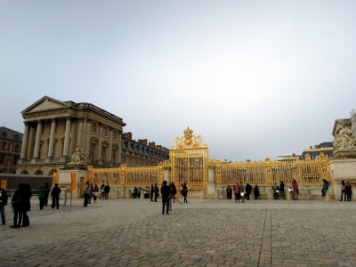 Golden entrance gate to Palace of Versailles