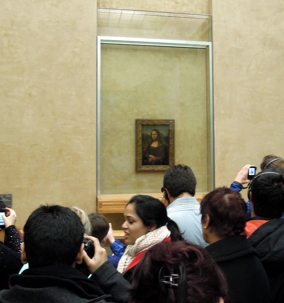 The Mona Lisa, surrounded by people and cameras