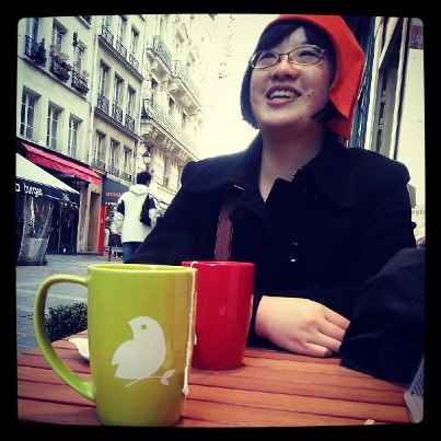 Lisa in new hat, with tea. Photo by Jenny (Jinny) Ly Ha.