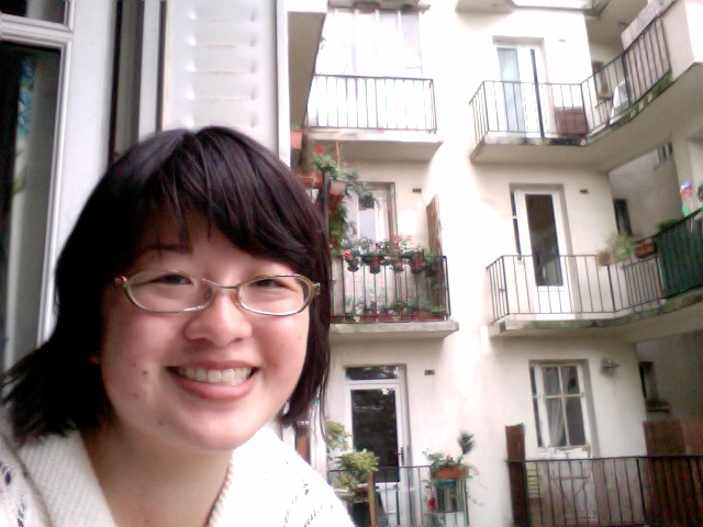 Lisa at window of Paris apartment