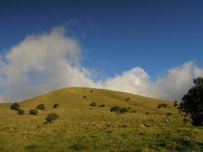 Picture-perfect green hill, blue sky