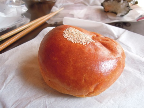 Red bean bun with circle pattern of little seeds on top