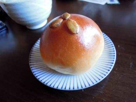 Adorable round bun with seeds on top