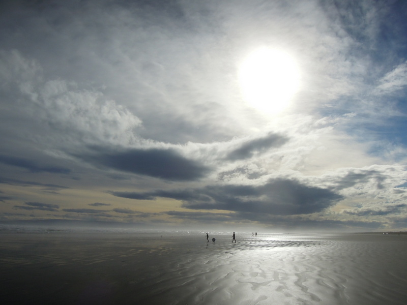 Walkers on Oreti Beach, New Zealand