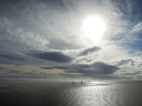 Walkers on Oreti Beach, New Zealand