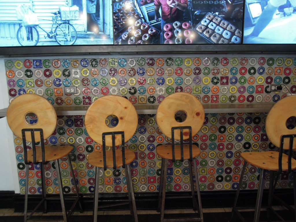 Counter with donut-shaped tiles and chair backs