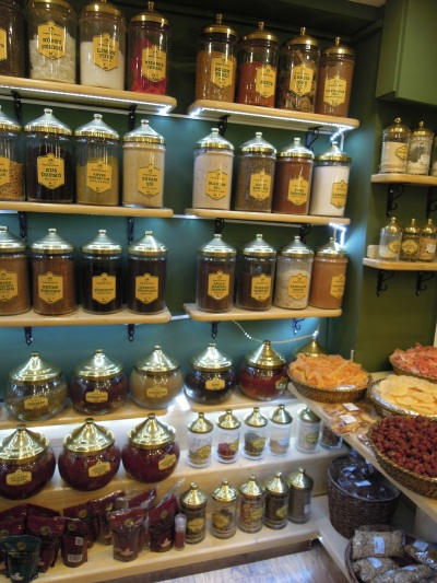 Dried fruit in baskets, herbs and spices in jars. Besiktas Aktari shop, Istanbul