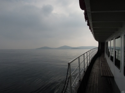 View of the Sea of Marmara, the edge of a ferryboat railing, and distant islands