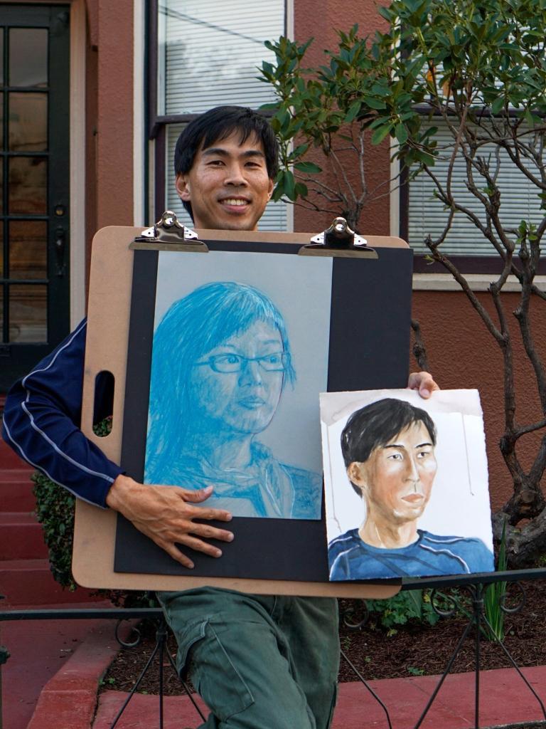 Man holding artworks
