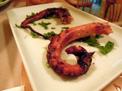 Two grilled octopus tentacles on a plate