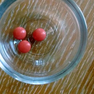 three Advil in a glass bowl