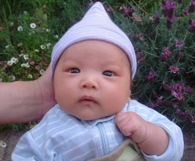 Seven-week-old baby Ada with pointy hat