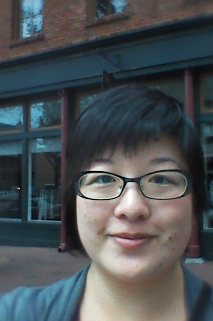 Lisa standing on the sidewalk