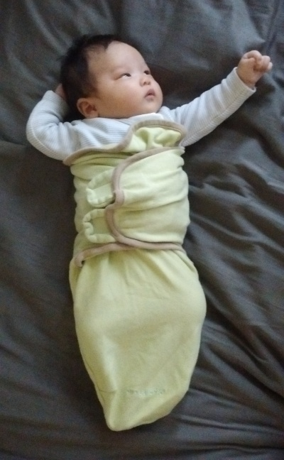 Seven-week-old Ada in pale green swaddle