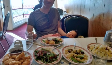 Erik holds two-month-old Ada while we have dinner at a Chinese restaurant