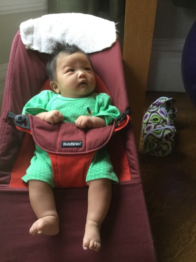 Two-month-old Ada in her bouncer