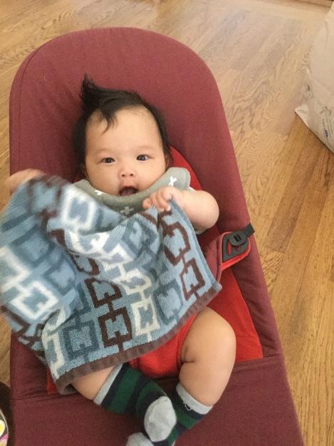 baby ada happily waving a washcloth