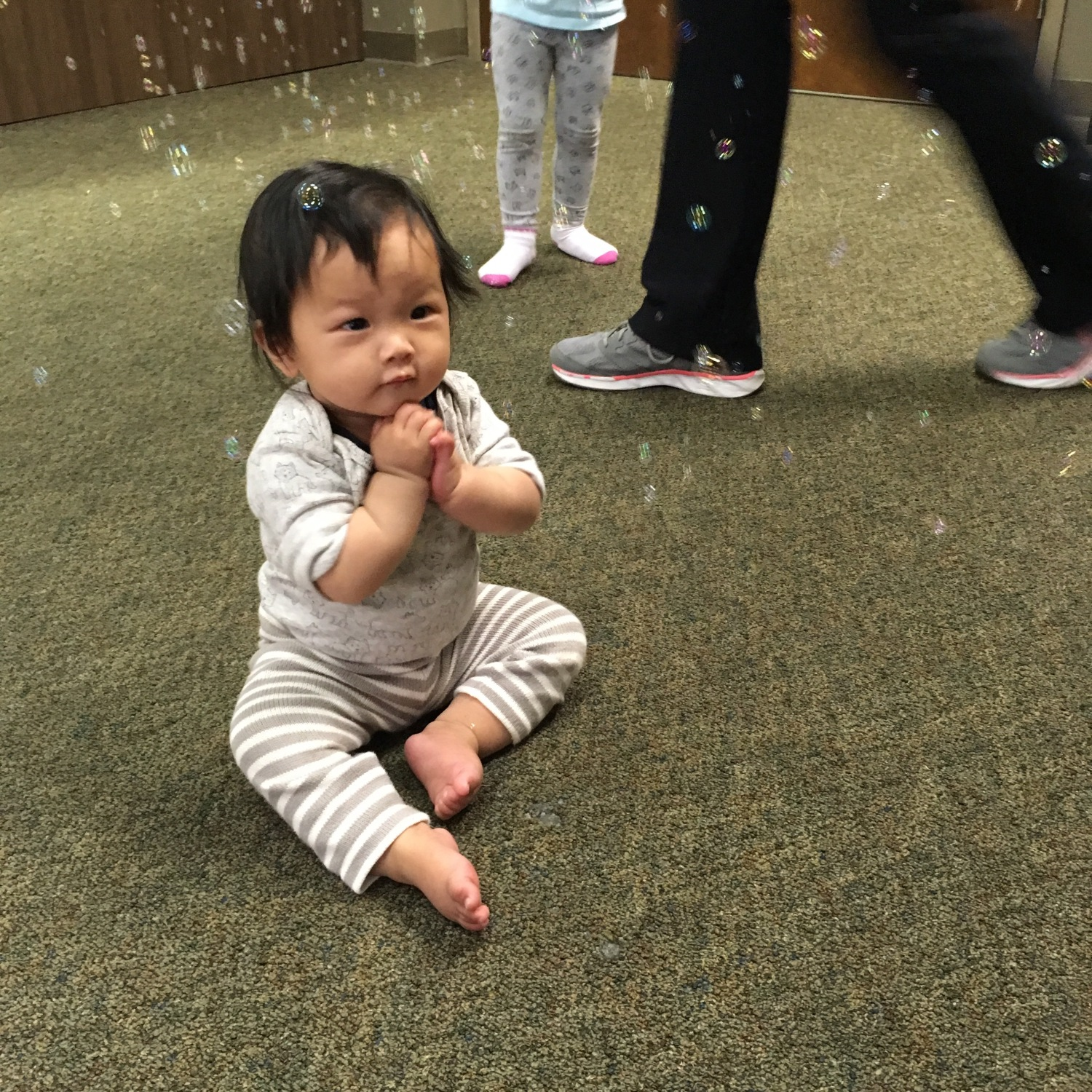 Baby Ada charmed by bubbles