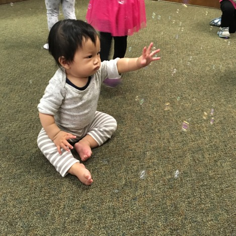 Baby Ada fascinated by bubbles