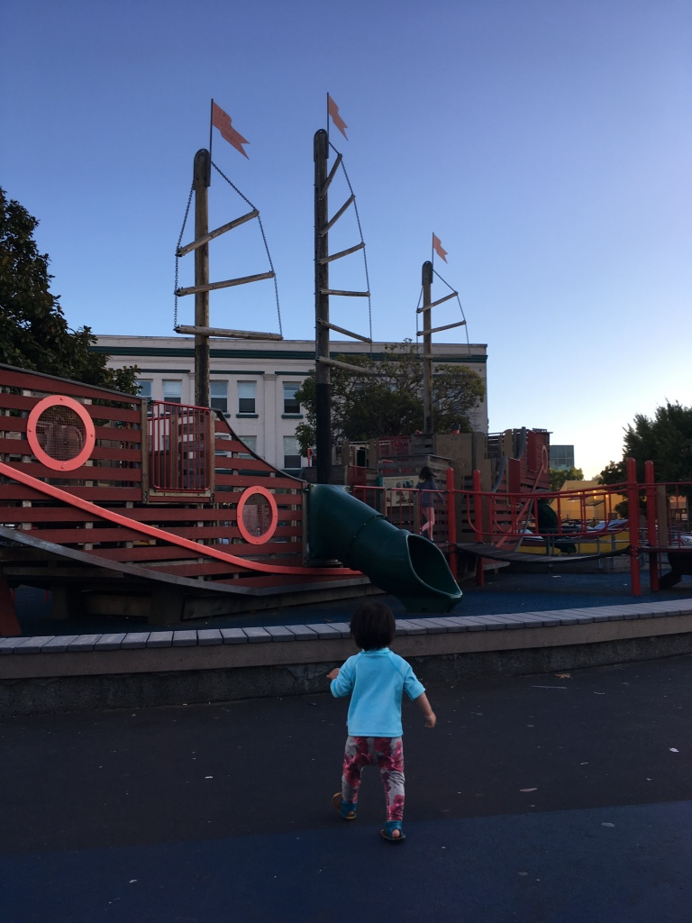 16-month-old Ada approaches a playground
