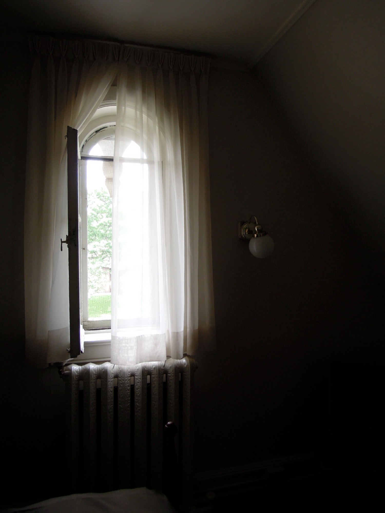 Sheer curtain over an open window
