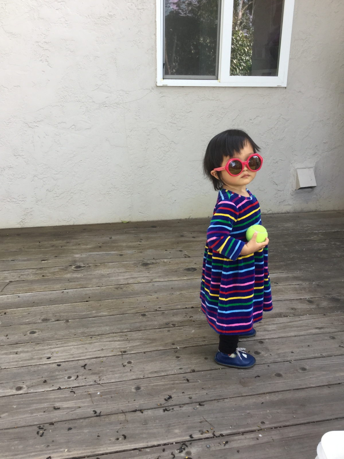 Toddler in red sunglasses