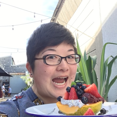 Lisa about to eat a fruit plate at Bondi Harvest cafe, Santa Monica