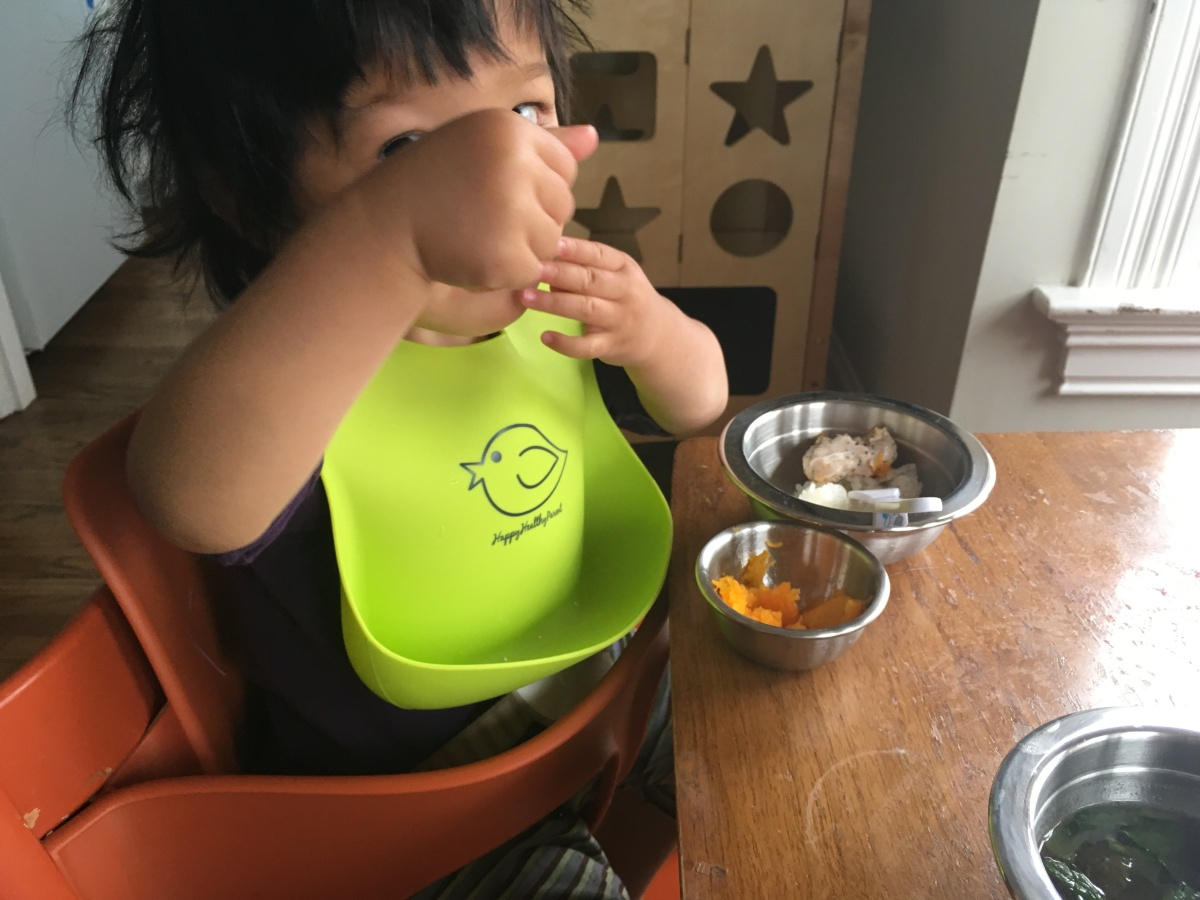 Toddler eating at the table