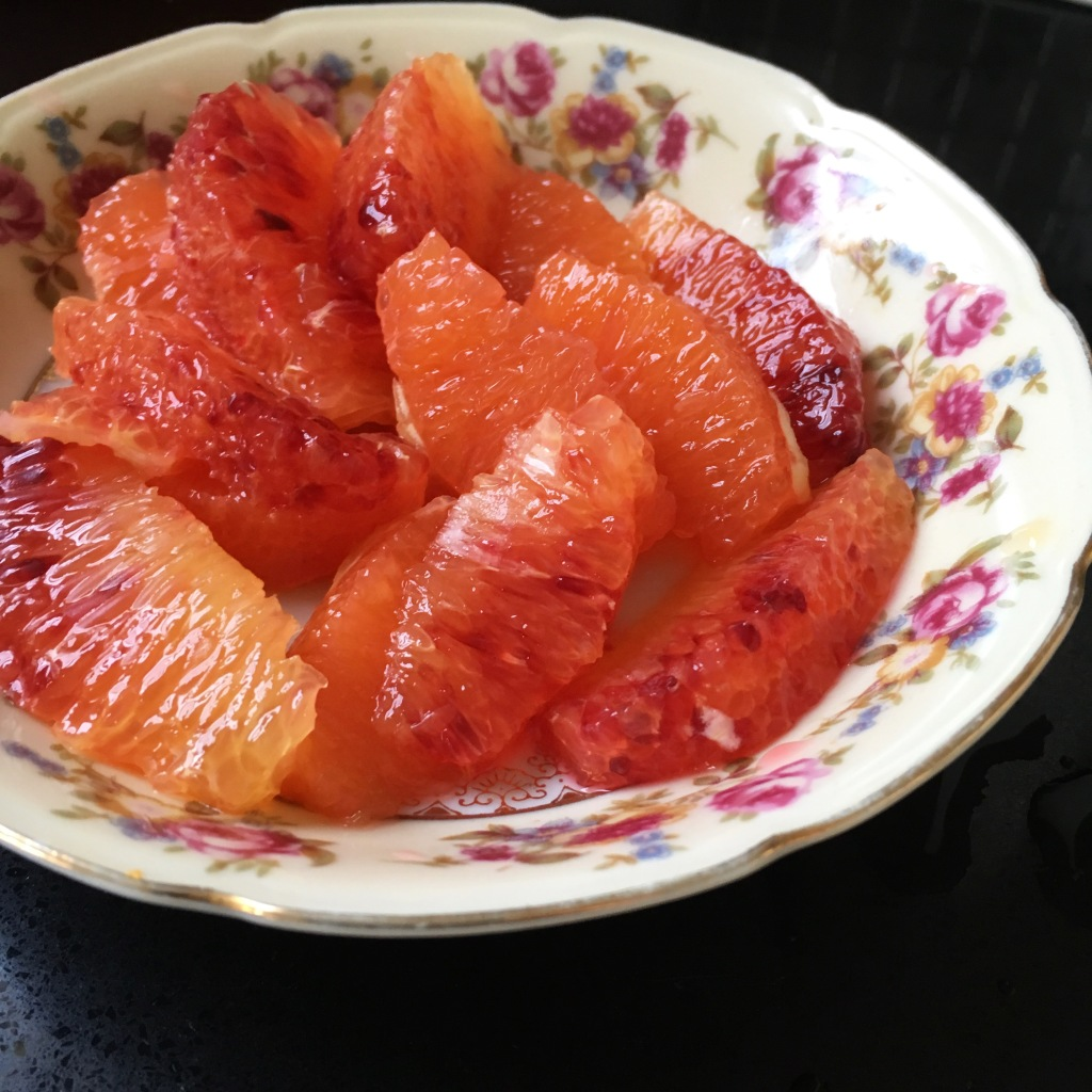 Blood orange and Cara Cara orange supremes in rose-patterned dish