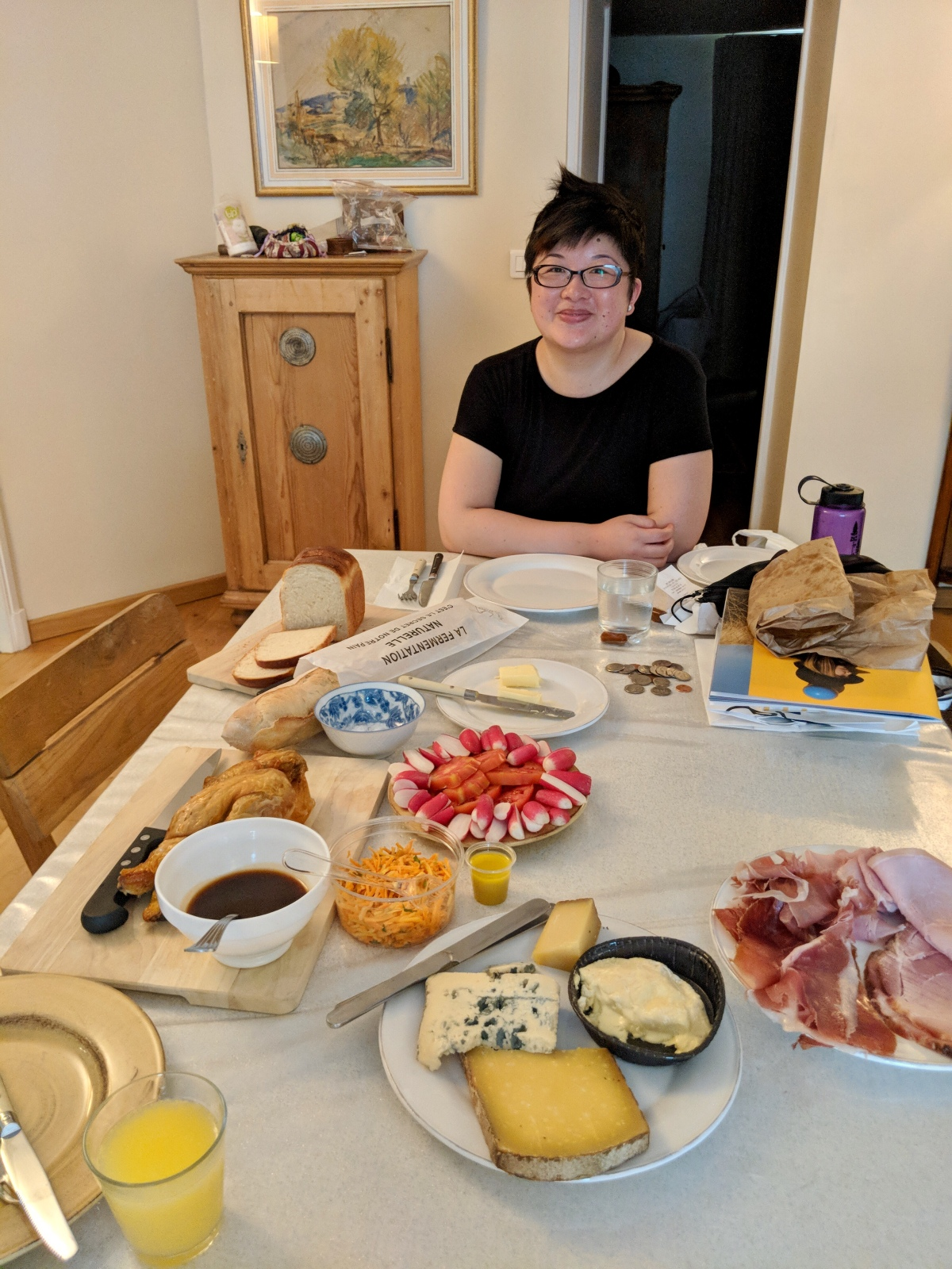 Lisa surrounded by cheese, ham, and other dinner items