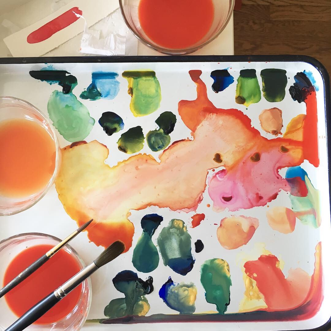Enameled metal butcher's tray being used as a paint palette